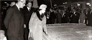 Her Majesty Queen Elizabeth II admires an OBEETEE rug.